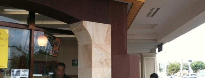 La vaquita negra del portal is one of Favoritos Deli.