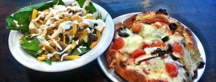 Revolve Pizza is one of Lieux qui ont plu à Suzanne E.