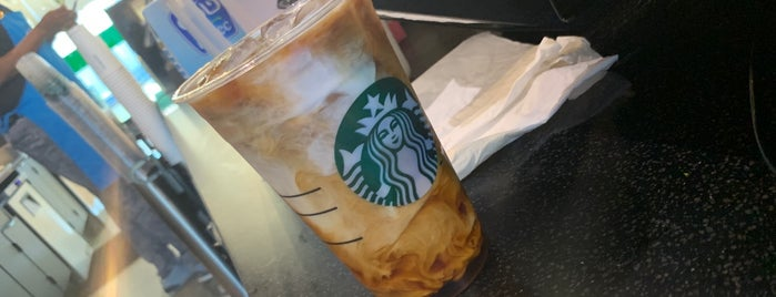 Starbucks KAEC is one of Orte, die Haitham gefallen.