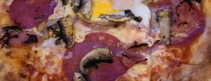 Pizzeria Dick & Doof is one of Orte, die Jonathan gefallen.