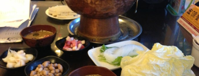 南门涮肉 Nan Men Hotpot is one of Locais curtidos por Simo.