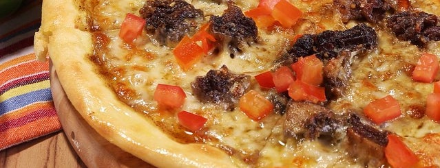 Tanggooe Pizzeria is one of + Pontianak.