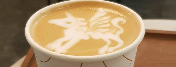 Huge Specialty Coffee is one of Locais curtidos por Abdullah.