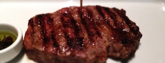 Dinho's Steak House is one of Gastronomia.