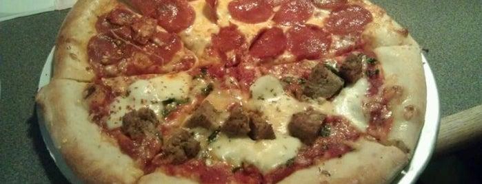 Dewey's Pizza is one of สถานที่ที่บันทึกไว้ของ Evan.