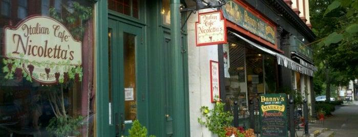 Nicoletta's Italian Cafe is one of Lizzie 님이 저장한 장소.