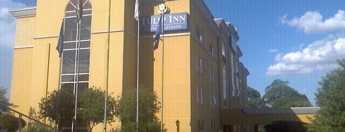 Tulip Inn is one of Orte, die Fernanda gefallen.