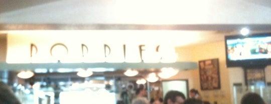 Poppies Restaurant & Deli is one of สถานที่ที่ Emily ถูกใจ.