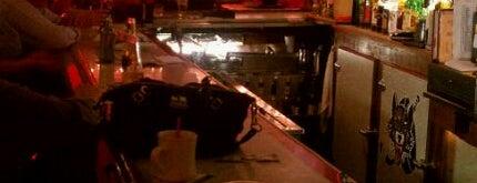 Dino's Pizza is one of Lugares guardados de T.