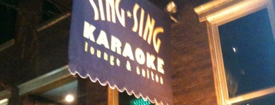 Sing Sing Karaoke is one of the man's hat is tan.