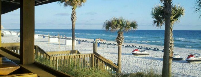 Spinnaker Beach Club & Paradise Grill is one of สถานที่ที่ Tim ถูกใจ.