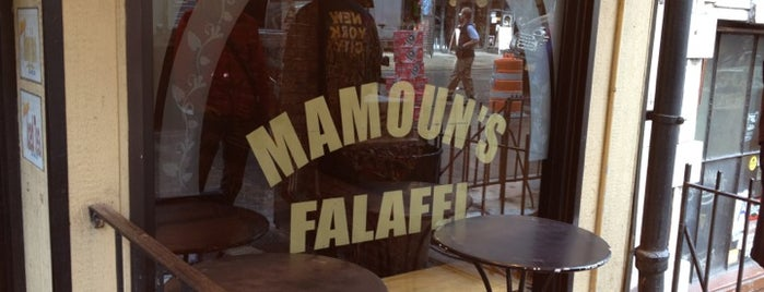 Mamoun's Falafel is one of the man's hat is tan.
