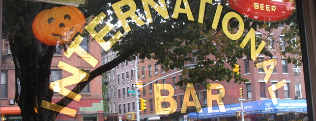 International Bar is one of the man's hat is tan.