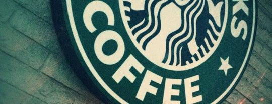 Starbucks is one of Orte, die Kris gefallen.
