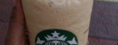 Starbucks is one of Orte, die Muriel gefallen.