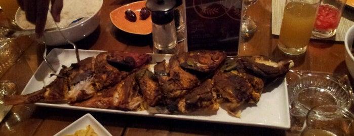 Feast Restaurant is one of Locais curtidos por Roa'a.