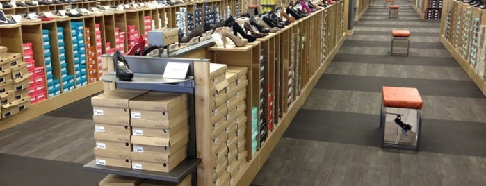 DSW Designer Shoe Warehouse is one of Heidi's Liked Places.