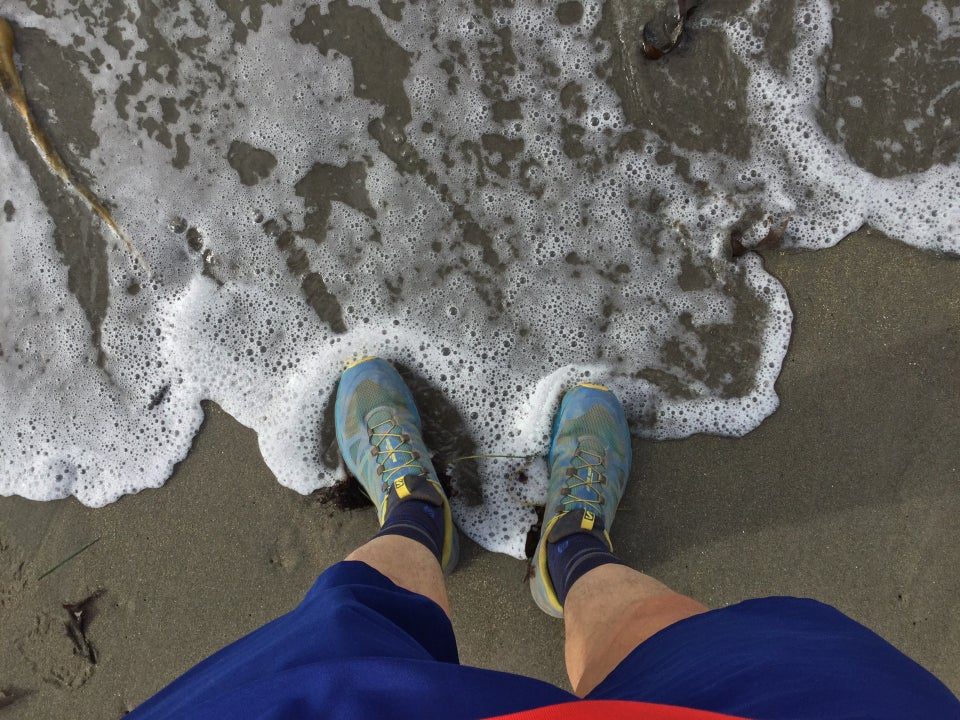 Looking down at my feet touching the surf at Muir beach.