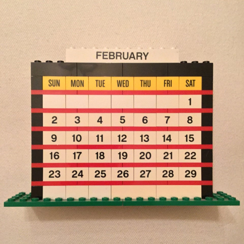 February of 2020 month calendar built from LEGO bricks, on an off-white background.