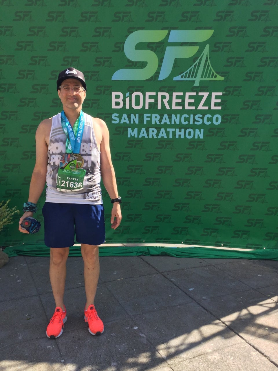 Tantek in his running outfit in front of the SF Biofreeze San Francisco marathon backdrop