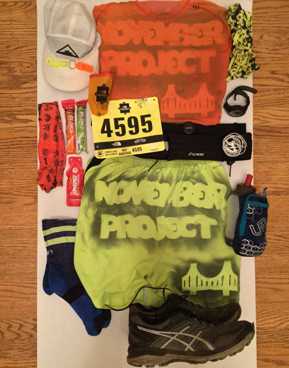 An array of running gear laid out for The North Face half marathon trail race.