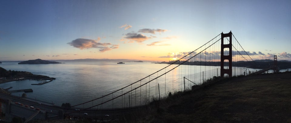 Panoramic photograph of sunrise over San Francisco and the bay, from Angel Island to Alcatraz to the city skyline, Golden Gate Bridge, and Sutro tower in the distance