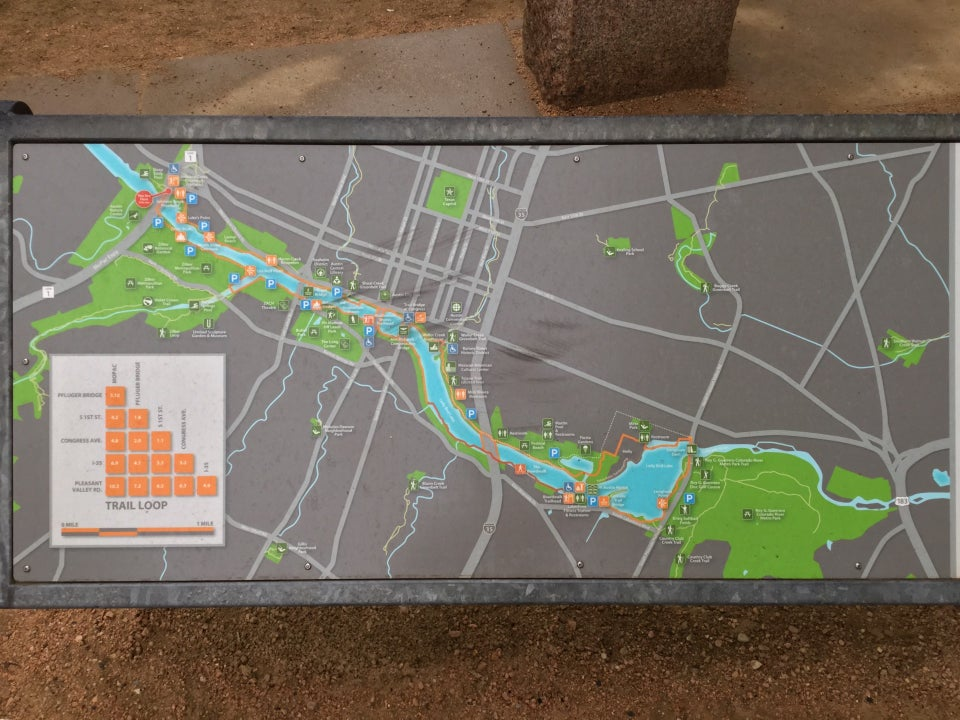 Map of the Lady Bird Lake trails, along with a chart in the lower left of distances between various checkpoints, the farthest being 10.2.