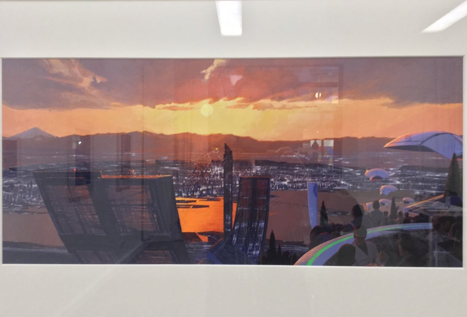 Photo-realistic painting with layer of clouds above a setting sun with an orange horizon above a distant mountain range behind broad flatlands with a dense city in a circular shape, an elevated observation platform in the foreground with people watching the sunset.