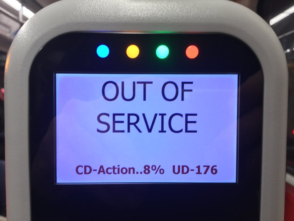 MUNI Clipper Card reader with blue yellow green red lights lit up, OUT OF SERVICE written in all caps, with a cryptic error message below: CD-Action..8% UD-176