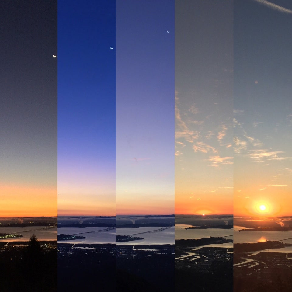 Five vertical slices showing the sky changing color over time as viewed from Mt. Tam, from orange on the horizong, to a deep blue sky above, lightening, then the sun cresting, and finally rising.