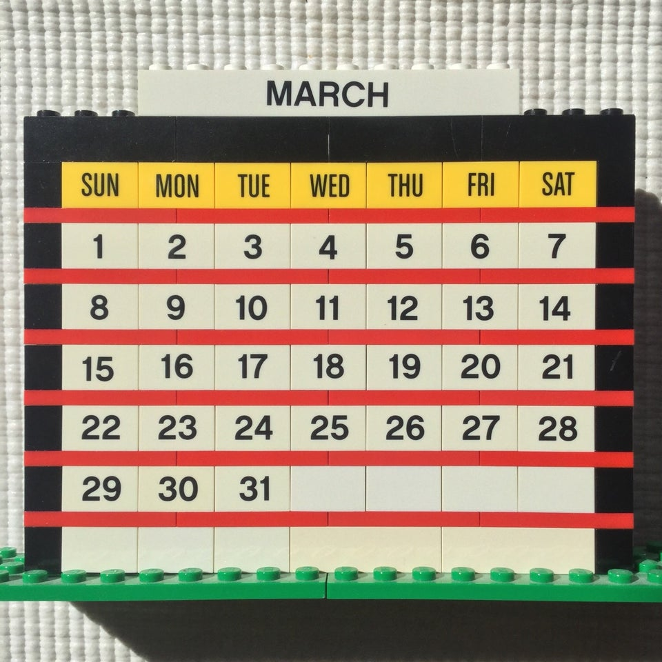 March of 2020 month calendar built from LEGO bricks, on an off-white background.