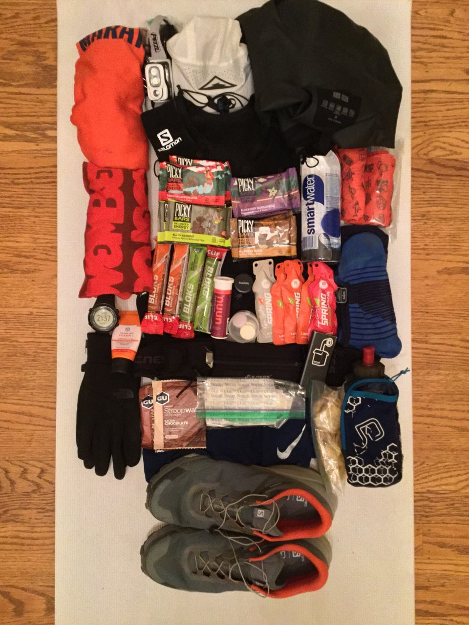 Race kit laid out on a yoga mat.