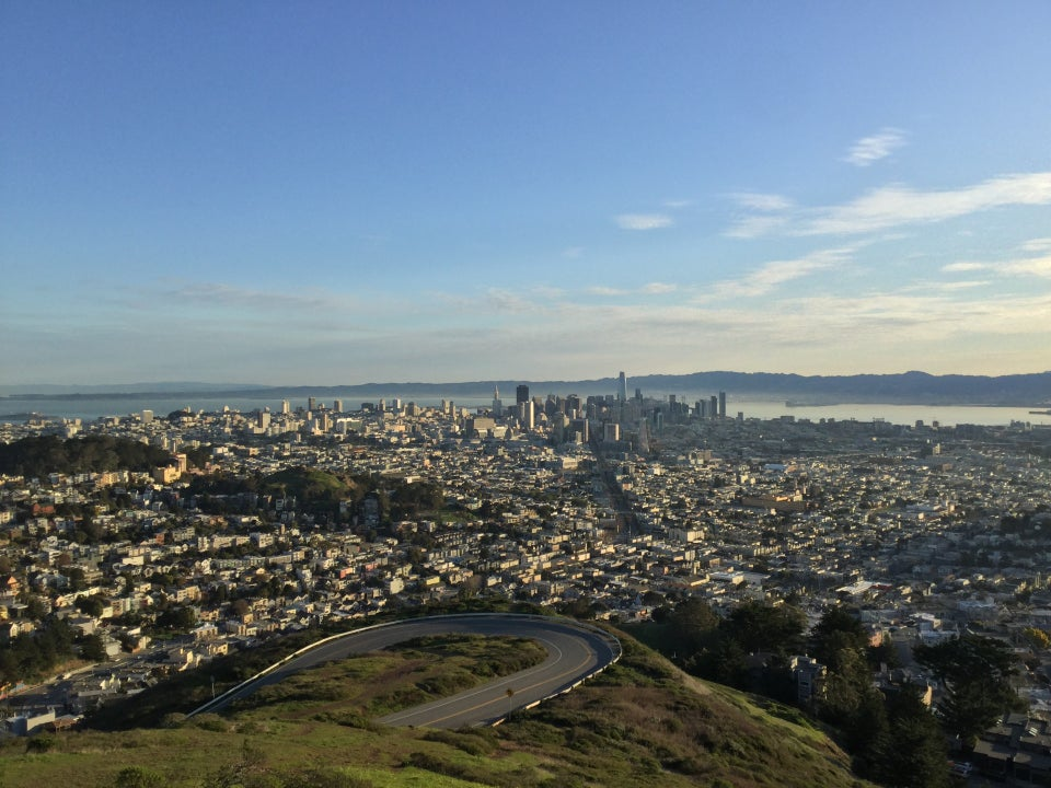 View from Twin Peaks in the morning of East Bay hills, downtown San Francisco, hairpin turn up Twin Peaks boulevard.