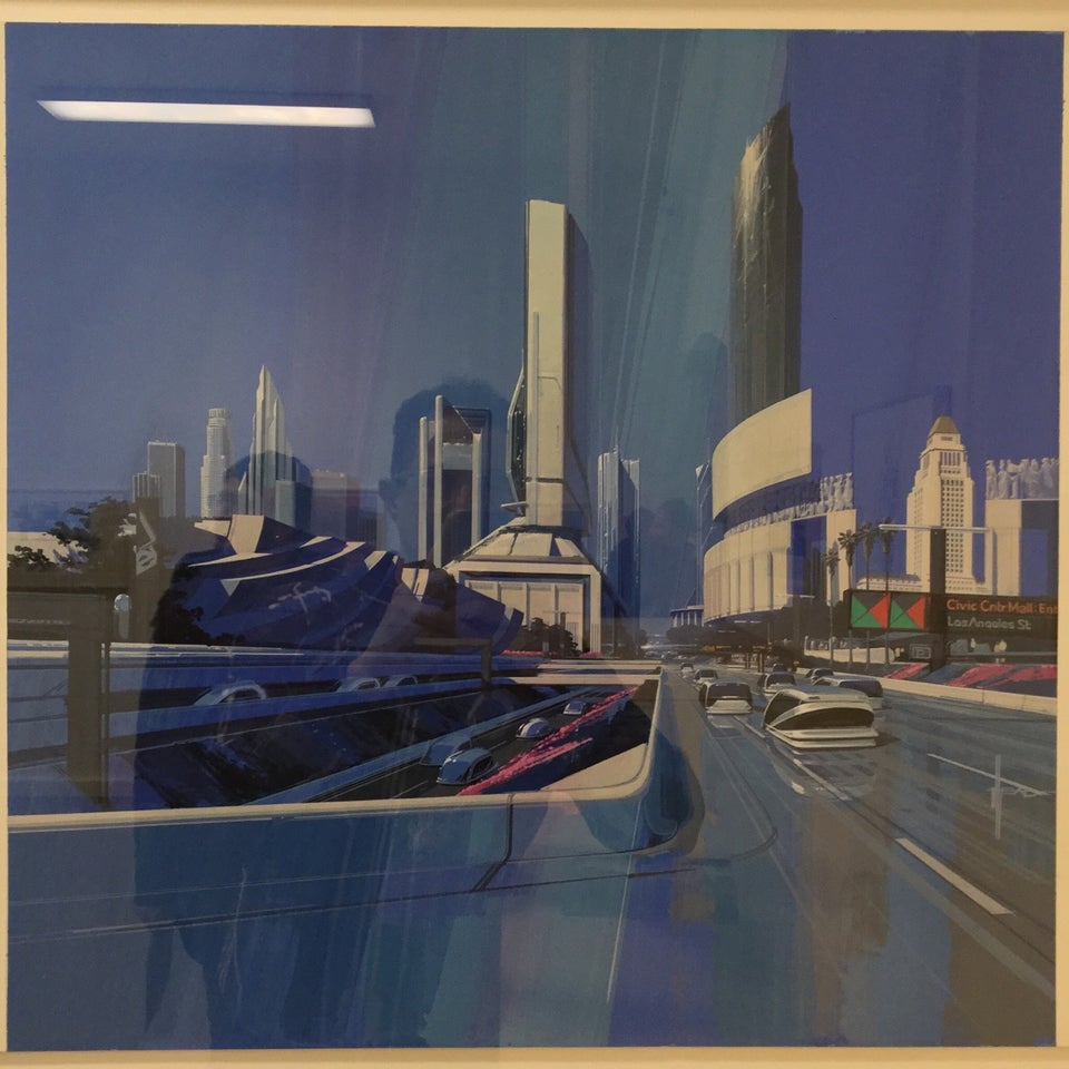 Photo-realistic painting of the cityscape of a future Los Angeles with both recognizable buildings like City Hall and downtown towers, as well as new futuristic buildings, highways, cars, and walkways.