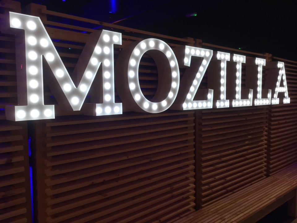 MOZILLA sign in bright lightbulbs on a wall.