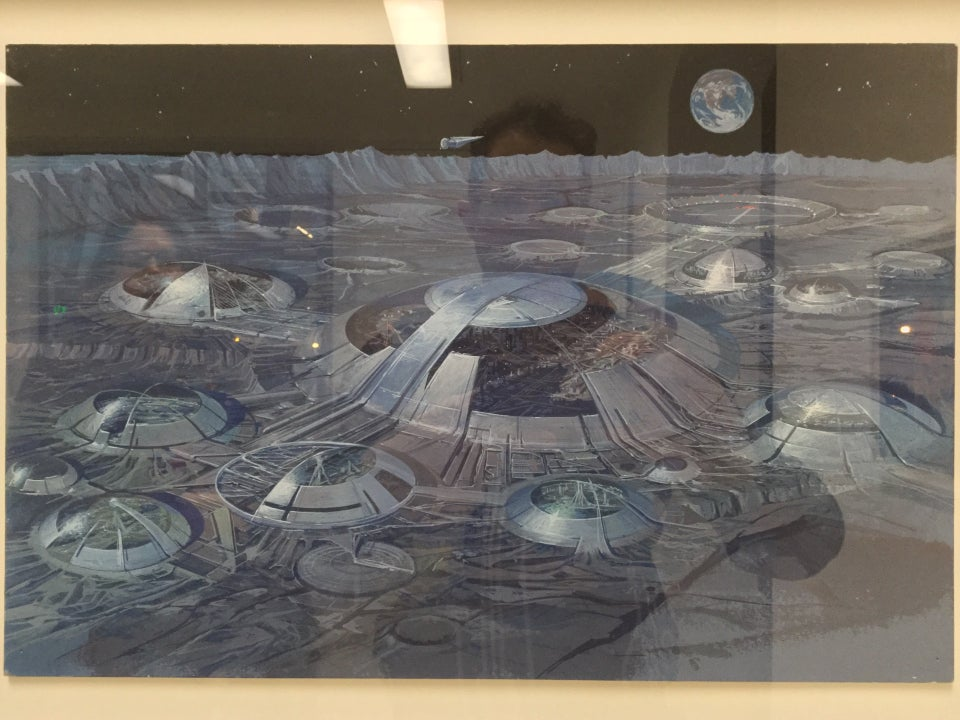 Photorealistic painting of the surface of a grey lunar landscape with a black starry night above, and a spread circular semi-transparent dome developments on the surface, networked together with corridors, mini-urban landscapes visible inside the domes.