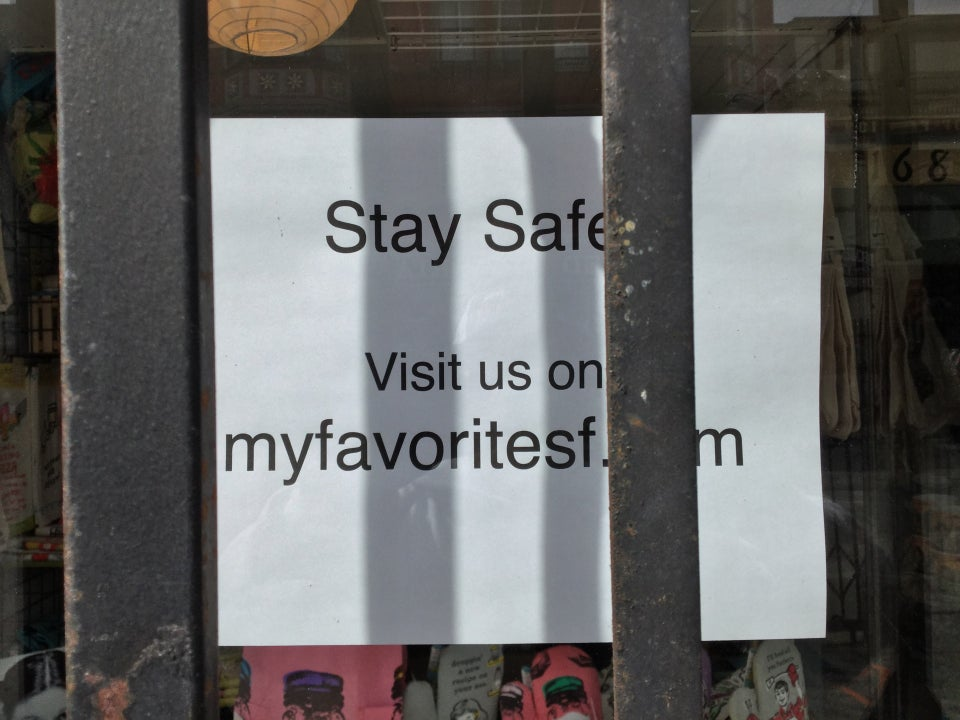 "Printed sign saying ""Stay Safe / Visit us on myfavoritesf._m"" with the ""co"" hidden behind a metal bar."