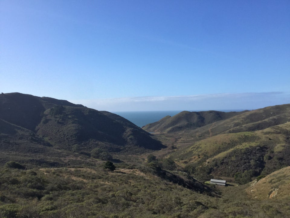 Tennessee Valley among Marin hills, Pacific Ocean visible between them.