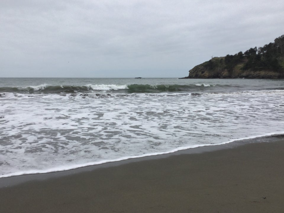 Wave breaking at Muir Beach under overcast skies